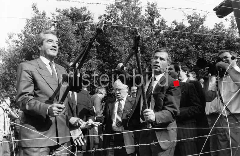 Austrian Foreign Minister Alois Mock (Left) And His Hungarian Counterpart Gyula Horn Cut The Barbed Wire In The Region Of Sopron, A Hungarian Border Town Near Austria, On June 27, 1989 After A Working Meeting Earlier In The Day. Hungary.