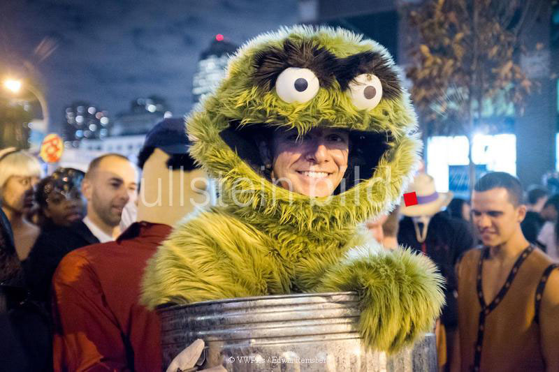 Man dressed up as Oscar the Grouch at a Halloween parade in New York City, USA