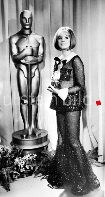Los Angeles: American actress Barbara Streisand holds her Oscar after she was named joint winner of the best actress award in the 41st annual academy awards here last night. Miss Streisand and Katharine Hepburn made Academy history by sharing the award. Singing star Miss Streisand gained her award for her role in Funny Girl, the first picture based on the life of comedienne Fanny Brice.  15 April 1969