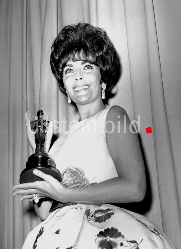 "Elizabeth Taylor holds her oscar after being named best actress for her part as the amateur call-girl in "" Butterfield 8 ""  21st April 1961"