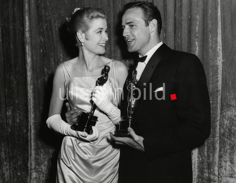 Grace Kelly and Marlon Brando at the 27th Annual Academy Awards, 1955