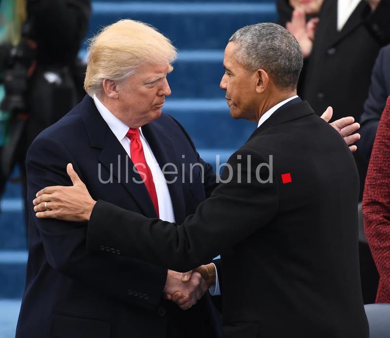 President Donald Trump shakes hands with ex-President Barack Obama